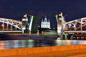 Smolniy cathedral and movable bridge in St-Petersburg — Stock Photo