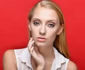 Portrait of the beautiful blonde woman in studio — Zdjęcie stockowe