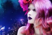 Beautiful girl with pink hair,  profile against the lights of  night city — Stock Photo
