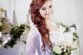 Happy bride with a bouquet, close-up — Stock Photo
