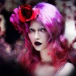 Beautiful girl with pink hair, amid a festive flare — Stock Photo #72505389