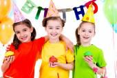Girls holding colorful cakes. — Stock Photo