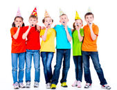 Children with party blowers. — Stock Photo