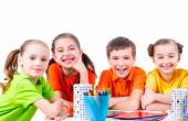 Children sitting at table. — Stock Photo