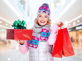 Woman with gifts — Stock Photo