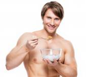 Man eating flakes. — Stock Photo