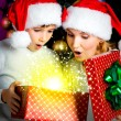 Mother with child opens the box with gifts on christmas — Zdjęcie stockowe #54824225