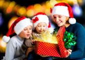 Mother with children opens the box with gifts — Stock Photo