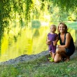 Mother with kid near lake — Stock Photo #55066857
