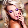 Woman with purple nails and makeup — Stockfoto #55490069