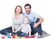 Young family playing with baby. — Stock Photo