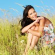Young beautiful smiling woman outdoors — Stock Photo #57506633