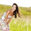 Young beautiful smiling woman outdoors — Stock Photo #57506677