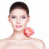 Beautiful woman with pink rose. — Stock Photo