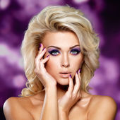 Beautiful woman with purple makeup — Stock Photo