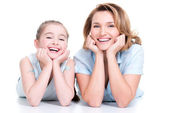 Smiling mother and young daughter — Stock Photo