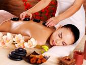 Adult woman having stone massage — Stock Photo