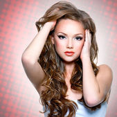 Beautiful girl with long curly hairs — Stock Photo