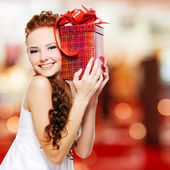 Happy woman with birthday present — Stock Photo