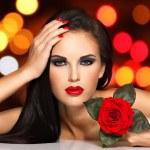 Beautiful woman with fashion makeup — Stock Photo #58975275