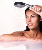 Woman holds shower in hands — Stock Photo