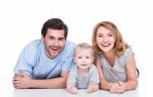 Smiling young parents with little child — Photo