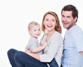 Heureux jeune famille avec enfant — Photo