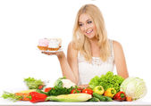 Woman with vegetables and cake — Stock Photo