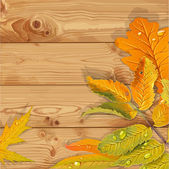 Yellow and green autumn leaves wooden background — Vector de stock