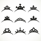 Set of silhouettes of tiaras of various shapes on a white backgr — Stock Vector