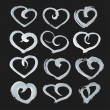 Big set of hand-drawn heart shape paint on black paper — Stock Vector #59826801