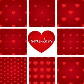Set of red seamless geometric patterns from hearts — Stock Vector
