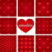 набор красных бесшовных геометрических образцов от сердец — Cтоковый вектор