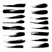 A large set of broad strokes texture in black ink on white paper — Stock Vector