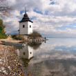 Reflection of tower at Liptovska Mara, Slovakia — Stock Photo #55255145