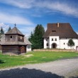 Wooden tower and manor in Pribylina, Slovakia — Stock Photo #57349561