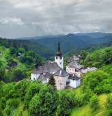 A cloudy view of Church of the Transfiguration, Spania Dolina — Stock Photo