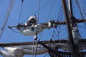 Crew unfurls a sail  — Stockfoto