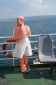 Veiled young woman on deck of ferry  — Foto de Stock