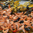 Shrimp, mussels and paella — Stock Photo #57560107