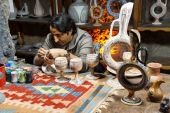 Artist paints unfired pottery — Stock Photo