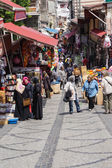 Locals and tourists mingle in the backstreet market — Stock Photo