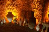 Pottery displayed in cave factory — Stock Photo