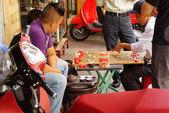 Men playing Chinese chess game — Stock Photo