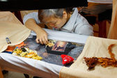 Workers embroider with silk — Stock Photo