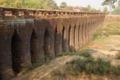 Sturdy corbeled arches of  Angkor bridge, — Stock Photo