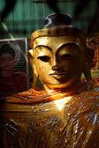 Golden head of Buddha — Stock Photo