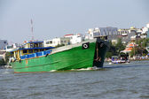 Large green cargo boat — Stock Photo