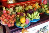Offerings of fruit to fertility deity — Stock Photo