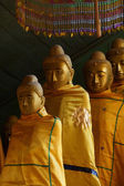 Buddhist monks with topknots — Stock Photo